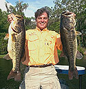 Doug Hannon with two bass.